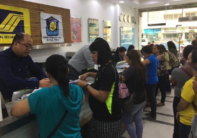 filipinos in a bank remitting money