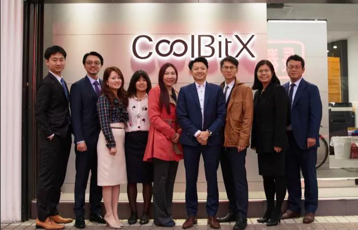 Michael Ou and CoolBitX team members outside the company's Taipei headquarters